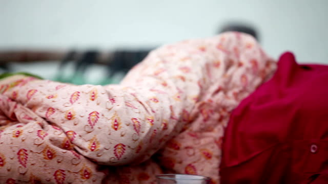 grandmother relaxing on cot or charpai - senior women stock videos & royalty-free footage