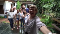 Grandmother taking a selfie with family
