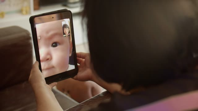 grandmother talks to grandchild on tablet - video call stock videos & royalty-free footage