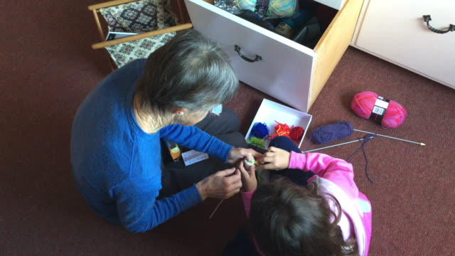 grandmother teaching her granddaugther to sew - knitting needle stock videos & royalty-free footage