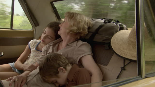 ms, grandmother with boy (6-7) and girl (10-11) sleeping on car back seat, tamborine mountain, brisbane, queensland, australia - vehicle seat stock videos & royalty-free footage