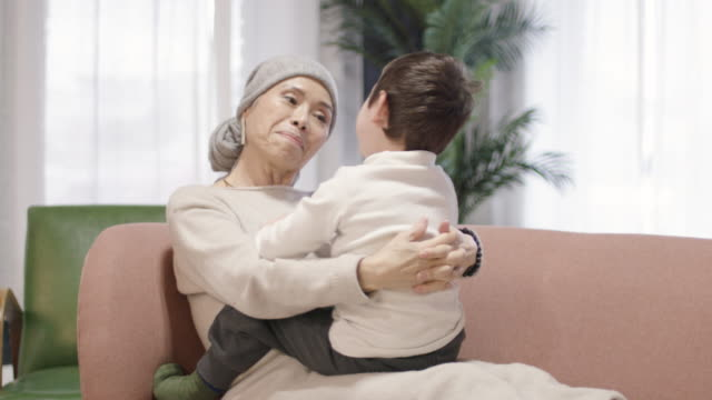grandmother with cancer playing with her grandson - cancer illness stock videos & royalty-free footage