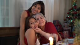 Grandmother with Granddaughters Portrait at Christmas Dinner