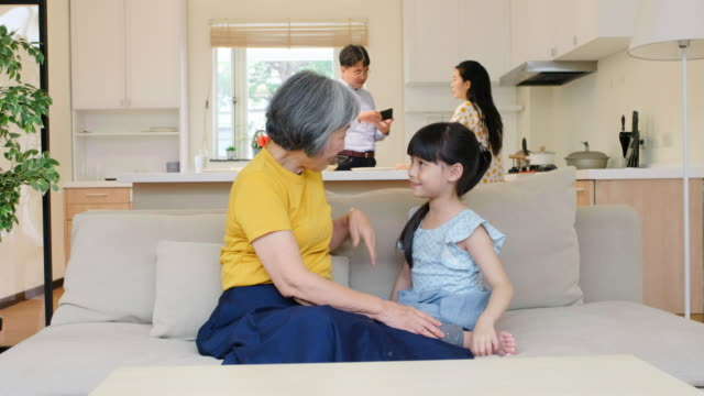 grandmother with her granddaughter in a home in taiwan - child care stock videos & royalty-free footage
