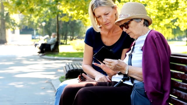grandmother with smart phone - adult offspring stock videos & royalty-free footage