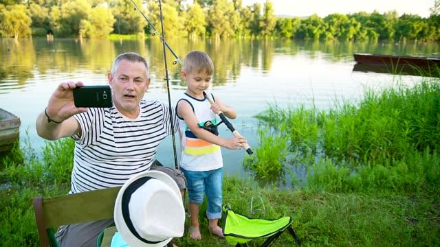 grandpa and grandson fishing - memories stock videos & royalty-free footage