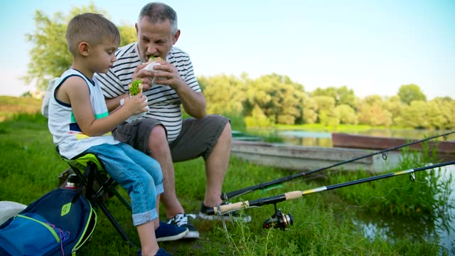 grandpa and grandson fishing - simple living stock videos & royalty-free footage