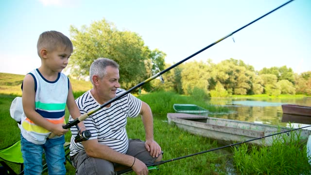 grandpa and grandson fishing - grandfather stock videos & royalty-free footage