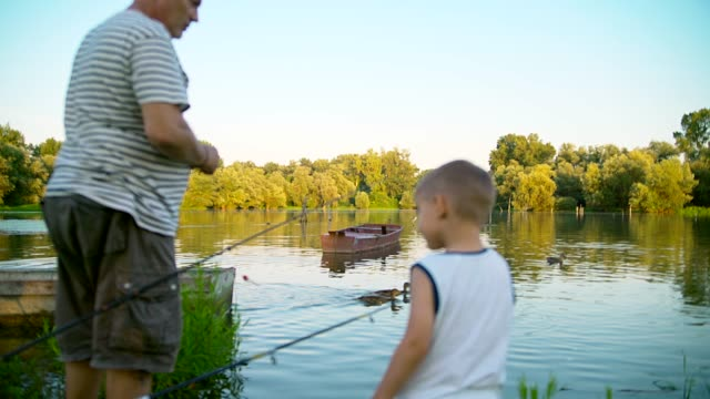grandpa and grandson fishing - multi generation family stock videos & royalty-free footage