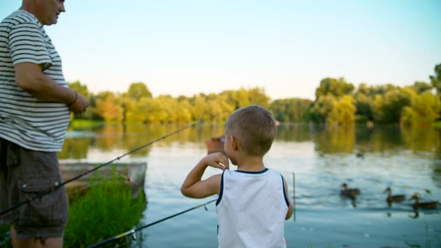 grandpa and grandson fishing - grandson stock videos & royalty-free footage