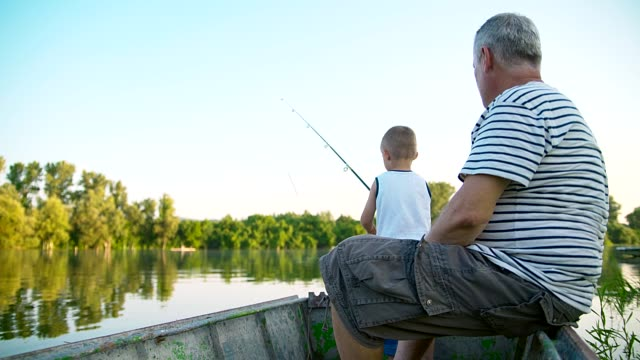grandpa and grandson fishing - grandson stock videos and b-roll footage