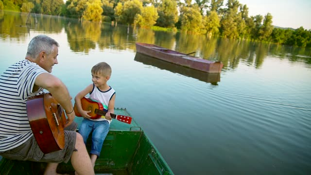 grandpa and grandson play guitar - next to stock videos & royalty-free footage