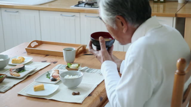 ms grandpa is eating breakfast in kitchen / fujikawaguchiko, yamanashi, japan - domestic kitchen stock videos & royalty-free footage