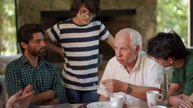 grandpa is the head of family - dining table stock videos & royalty-free footage