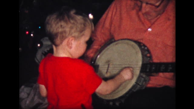 1957 grandpa plays banjo while boy helps - banjo stock videos & royalty-free footage