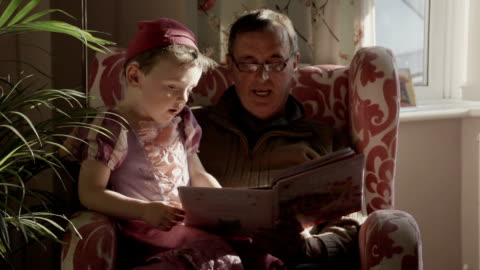 grandpa reading a story to his grandchildren - tights stock videos & royalty-free footage