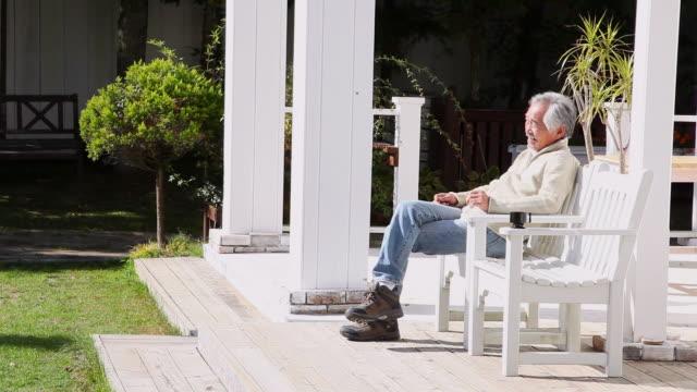 ms grandpa sitting on chair / fujikawaguchiko, yamanashi, japan - only mature men stock videos & royalty-free footage