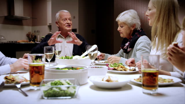 Grandpa telling a story at the dinner table