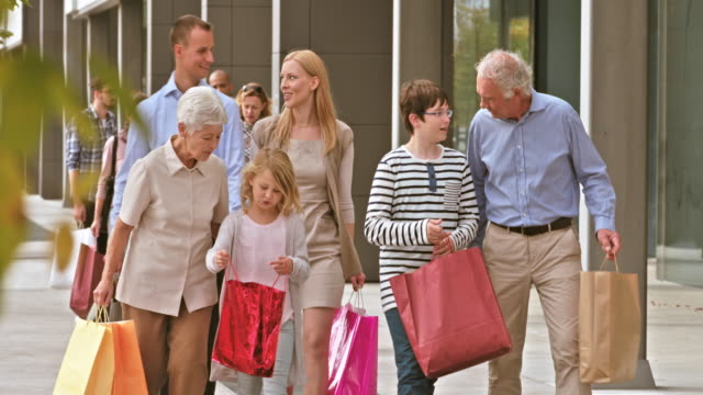 DS grandparent and grandkids with shopping bags