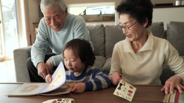 grandparent and grandson have fun in the living room - japanese ethnicity stock videos & royalty-free footage