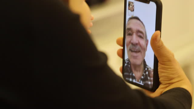 grandparent having video call with granddaughter - video call stock videos & royalty-free footage