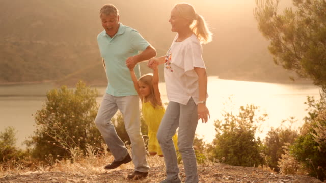 grandparents and grandchild in sunset in countryside - twilight stock videos & royalty-free footage
