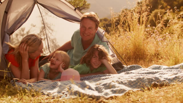 grandparents and grandchildren or older parents and children playing with tent in countryside - vier personen stock-videos und b-roll-filmmaterial