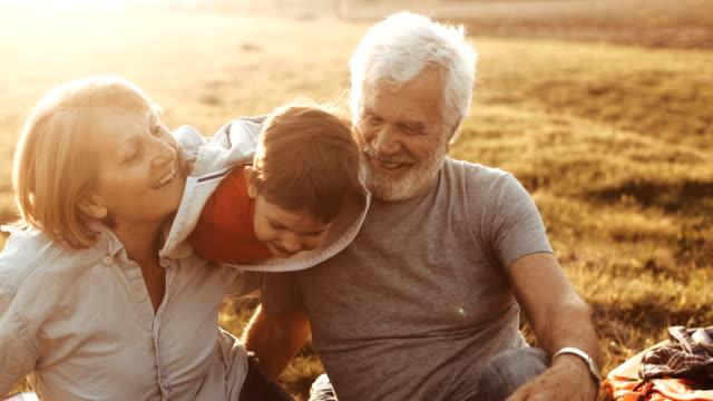 grandparents and grandson having fun outdoors - grandson stock videos & royalty-free footage
