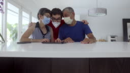Grandparents and grandson living together and wearing masks