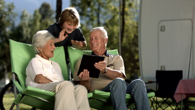 slo mo grandparents and grandson video chatting - motor home stock videos and b-roll footage