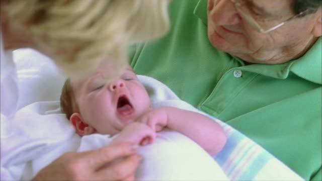 cu tu grandparents caressing newborn baby girl (0-1 months) / tampa, florida, usa - 0 1 months stock videos & royalty-free footage