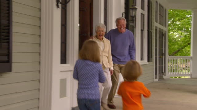 MS Grandparents greeting family at front door of home / Richmond, Virginia