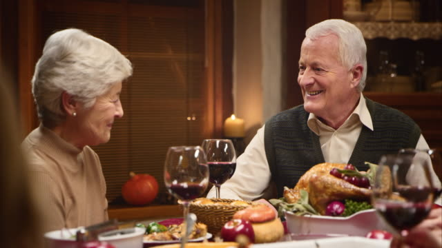 Grandparents having a lovely talk at the Thanksgiving table