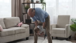 Grandparents playing with baby girl at home