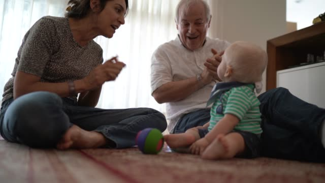 grandparents playing with grandson - grandparent stock videos & royalty-free footage