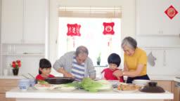 Grandparents preparing Chinese Year Dinner with their grandchildren