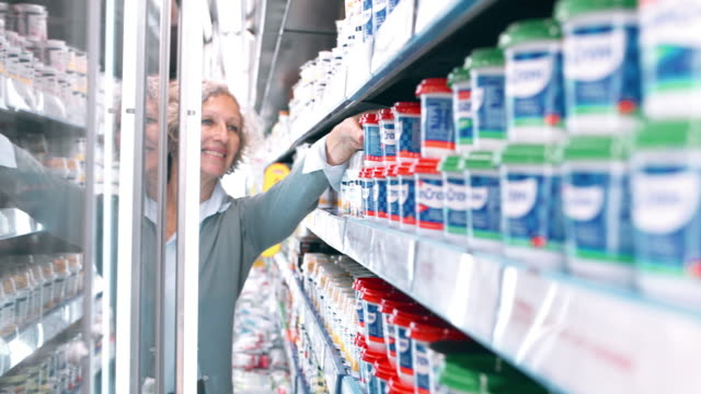 grandparents shopping with granddaughter in supermarket - open refrigerator stock videos & royalty-free footage