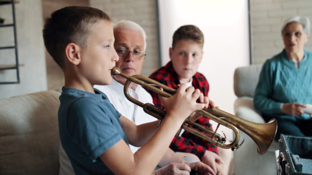 grandparents spending time with their grandsons - musical instrument stock videos & royalty-free footage
