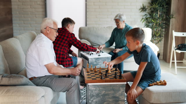 grandparents spending time with their grandsons - game night leisure activity stock videos & royalty-free footage