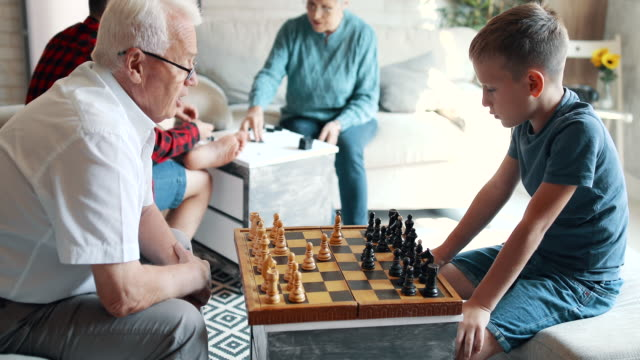 grandparents spending time with their grandsons - board game stock videos & royalty-free footage