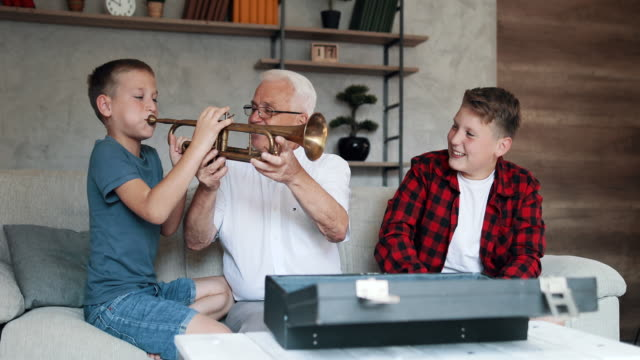 grandparents spending time with their grandsons - trumpet stock videos & royalty-free footage