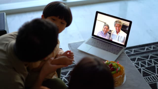 grandparents wishing their grandson happy birthday using video call - malaysia stock videos & royalty-free footage