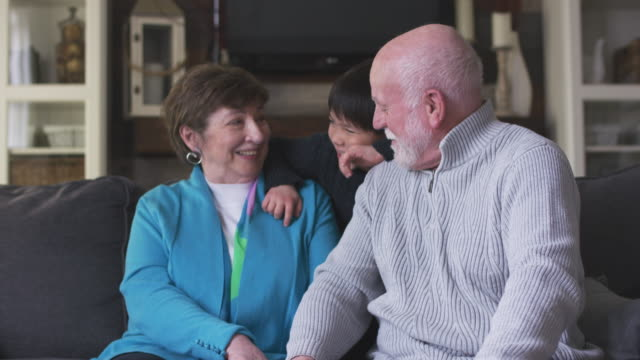 grandparents with their grandson - cosy stock videos & royalty-free footage