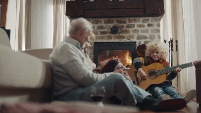 grandson playing guitar for his grandparents - human settlement stock videos & royalty-free footage