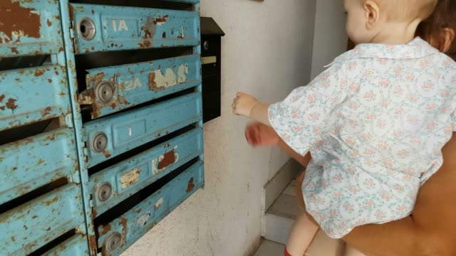 grandson with grandmother verifying mailbox - hugging self stock videos & royalty-free footage