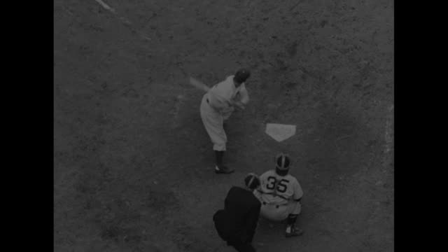 Grandstands of Ebbets Field / trombone players / AfricanAmerican man banging cymbals / VS 'Cookie' Lavagetto at bat hands on base of bat tilt...