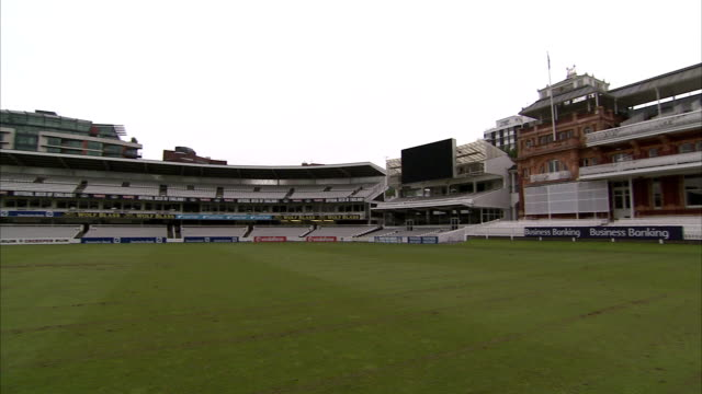 grandstands surround the field at the lord's cricket ground in london. available in hd. - lords cricket ground stock videos and b-roll footage