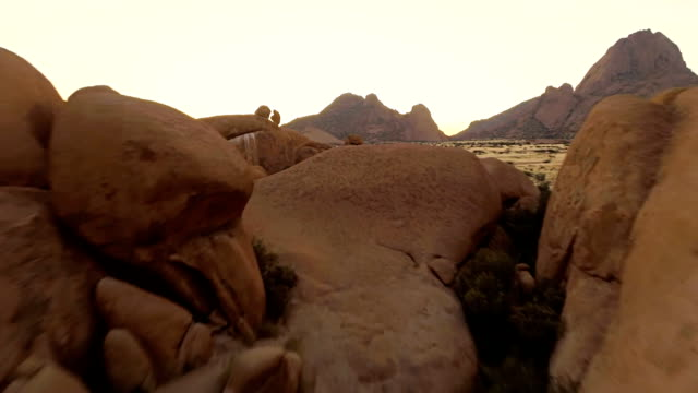 heli granite arch in the spitzkoppe - time stock videos & royalty-free footage