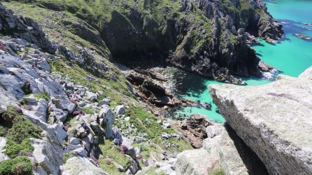 granite sea cliffs at bosigran on cornwall's north coast, uk, with people rock climbing. - granite rock stock videos & royalty-free footage