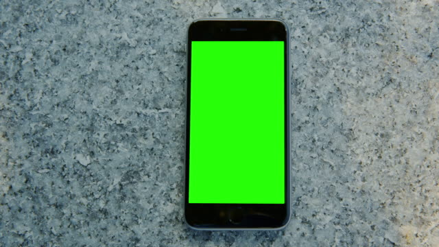 granite stone smart phone mobile green screen chromakey - shade stock videos & royalty-free footage